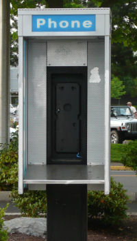 Empty pay phone stand in Oregon