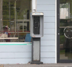 Empty pay phone stand at the laundromat