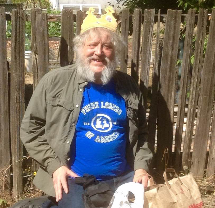 "Since September is ""National Hobo Month"", I propose that all listeners purchase a PLA t shirt and give it to a hobo. I did and by crackee I feel good about it.. Attached is a photo of a hobo that has been frequenting the neighborhood since spring. I gave him a PLA T-shirt, 5 dollars, a pack of smokes and crowned him ""King of the Hobos"". His joy brought tears to my eyes. I encourage all listeners when they purchase a t-shirt, buy another for a hobo of your choice . Already have a PLA Shirt, then buy another for a hobo. Make the world a little bit better. -Mr Hunga Dunga The Peoples Karma Squad."